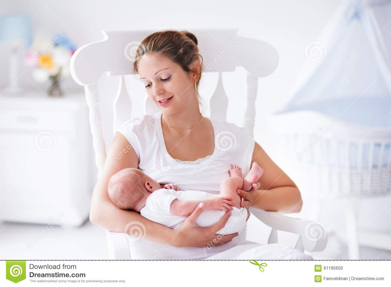 Baby Nursing Chair Mother And Newborn Baby In White Nursery Stock Photo