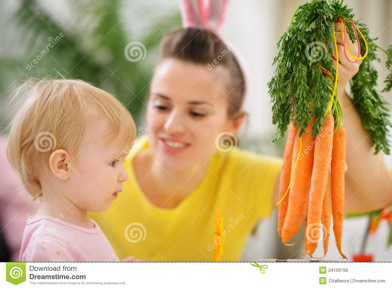 Woman washing carrots royalty free stock images apps