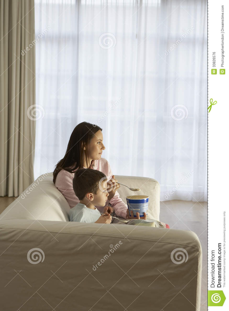 Sofa U Mother And Son Watching Tv Royalty Free Stock Image