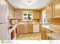 New Kitchen Cabinets With White Appliances Stock Photo ...
