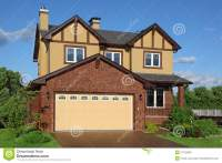 New Two-storied Brown Cottage With Built-in Garage Stock ...