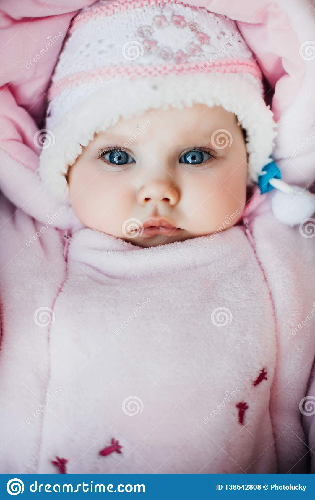 Newborn Babies With Blue Eyes Newborn Baby With Blue Eyes Looking At Camera Stock Photo
