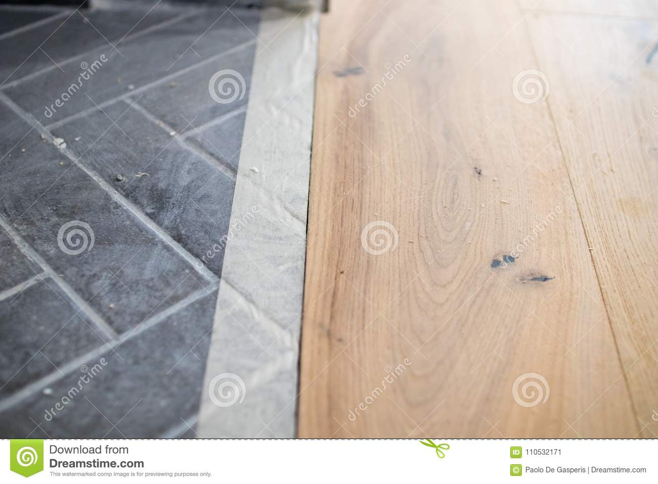 Renovation De Parquet Oak Colored Parquet During The Installation Compared With A Cement