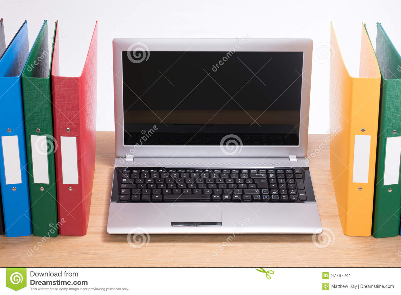 Timber Computer Desk Office Folders And Open Laptop Computer On Desk Stock Image