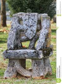 Old Unusual Empty Chair Tombstone Tree Trunks Stock Image
