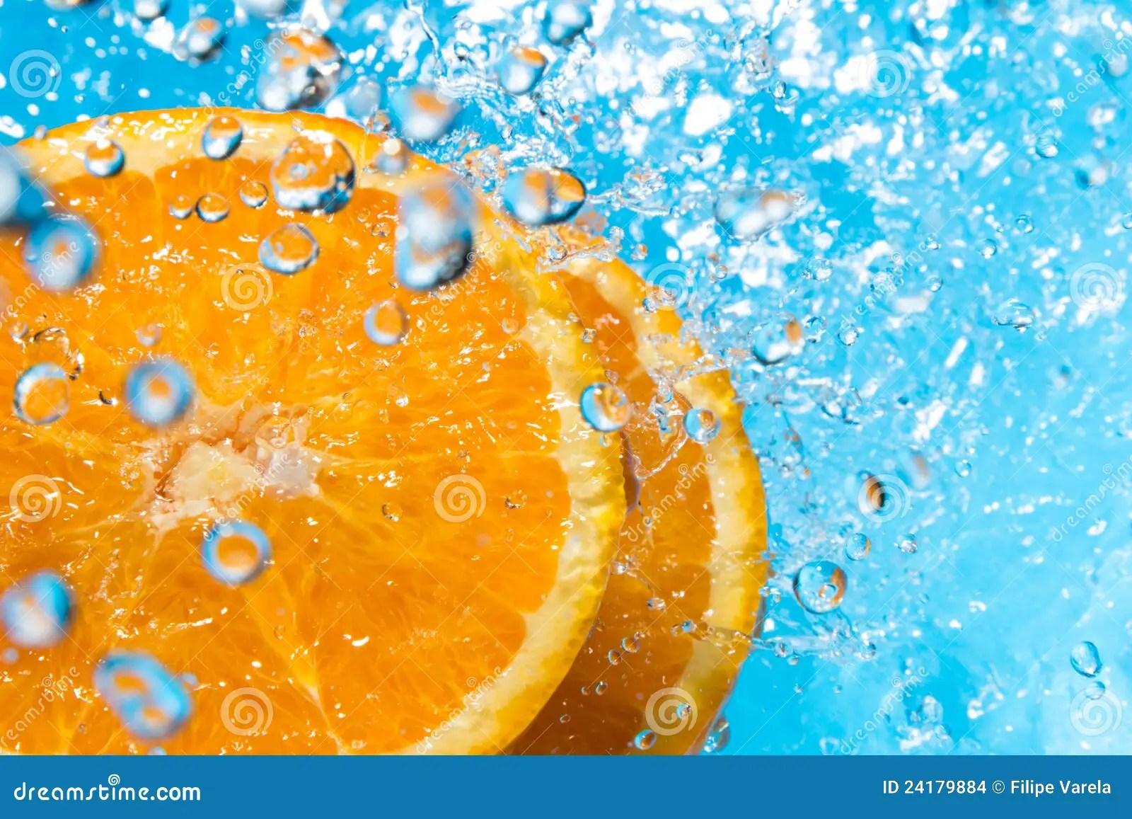 Falling Water Wallpaper Orange Splash In Water Top View Stock Images Image