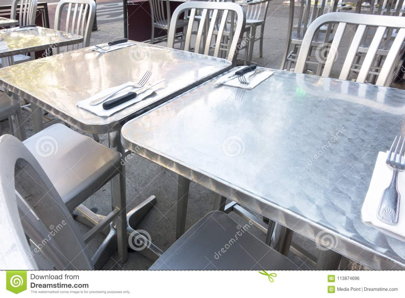 Stainless Restaurant Table Stainless Steel Outdoor Restaurant Table And Chairs Stock Photo