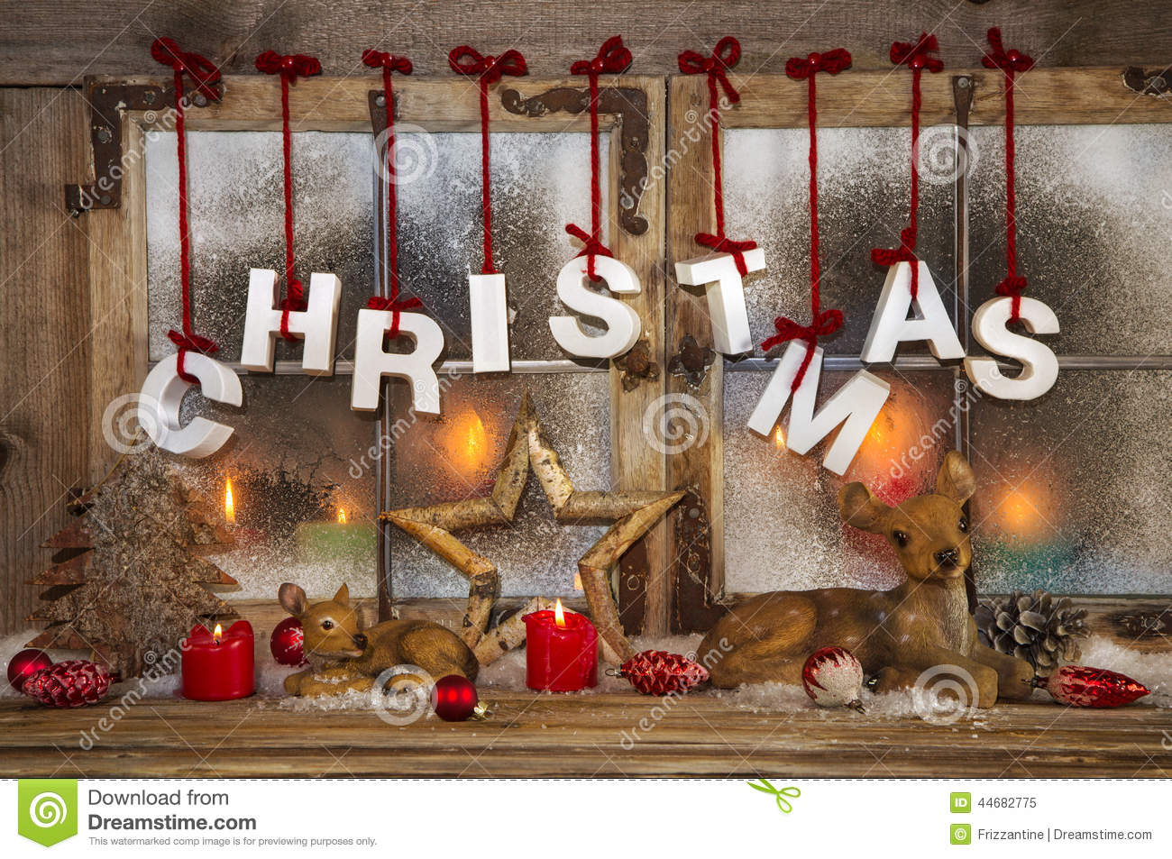 Outdoor christmas window decoration with red candles deer and t royalty free stock photo