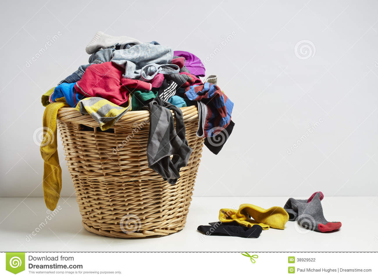 Clothes Baskets Laundry Basket Full Of Dirty Clothes And Softener Stock