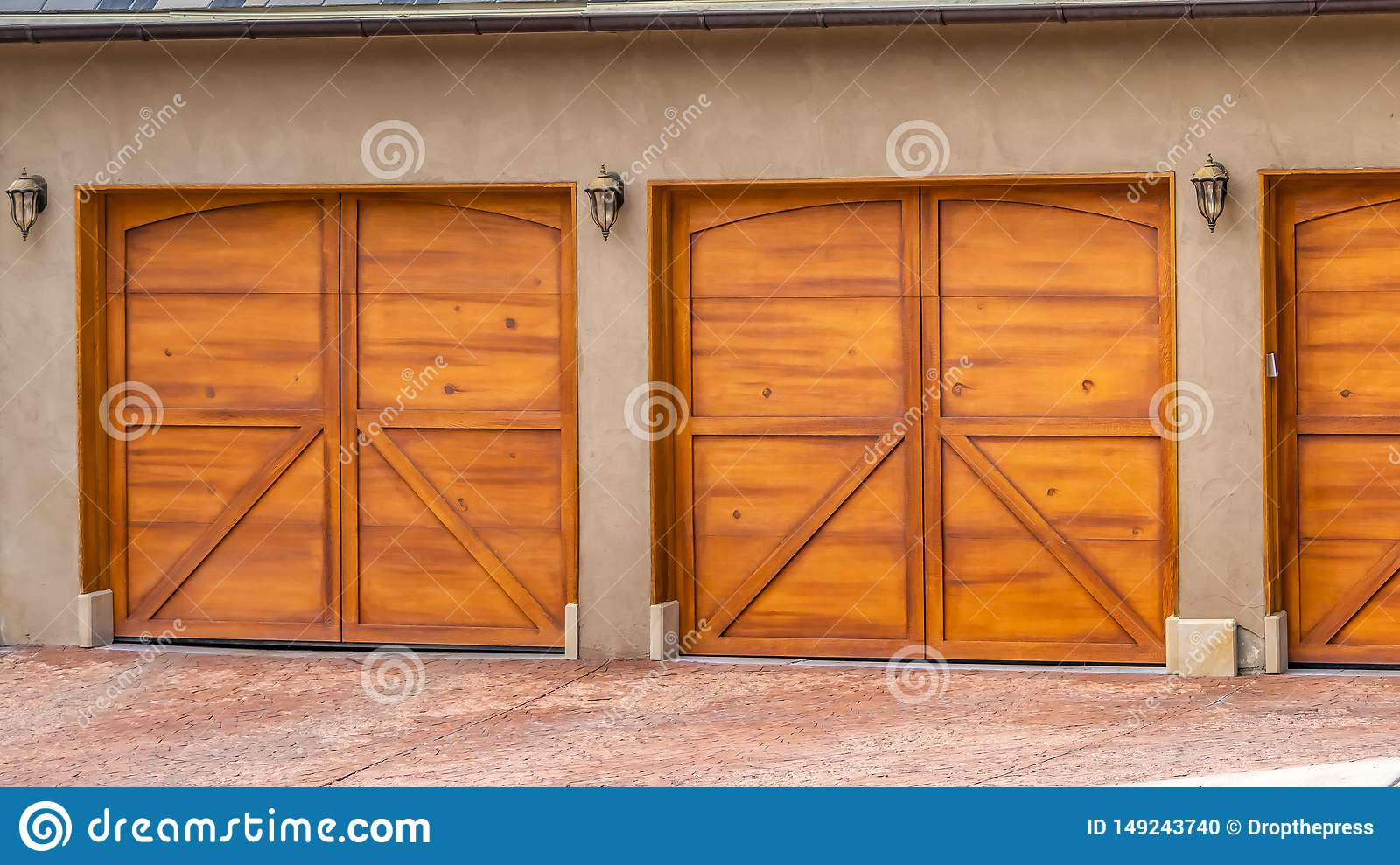 Panorama House Exterior With Gray And White Roof And Stylish Wooden Garage Doors Stock Photo Image Of Door Exterior 149243740