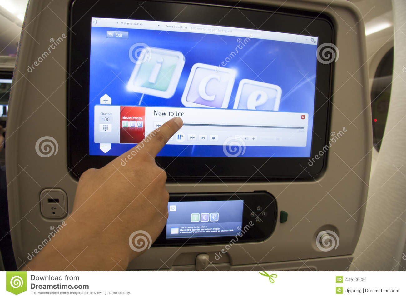 Aeroplane Fly Passenger Pointing At The Touch Screen In A Plane