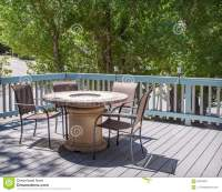 Patio Table With Fire Pit And Chairs On Deck Stock Photo ...