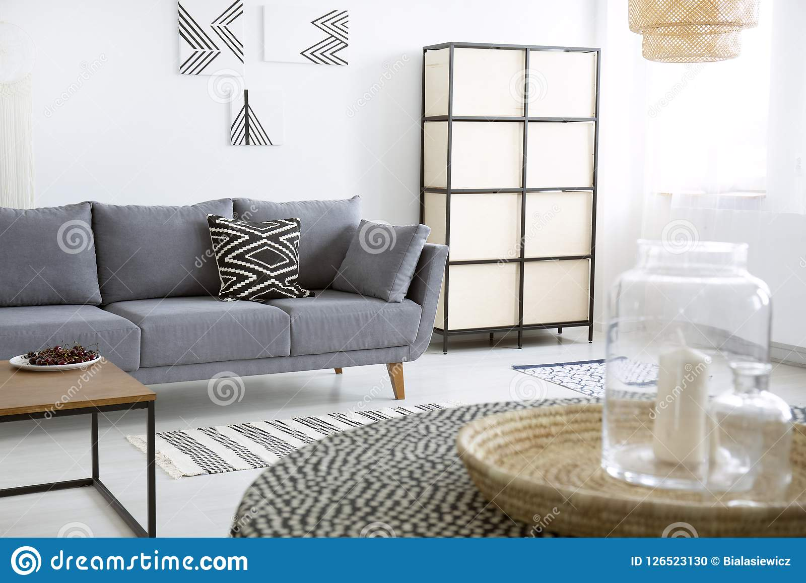 Sofa Next Grey Patterned Cushion On Grey Sofa Next To Screen In Modern Flat