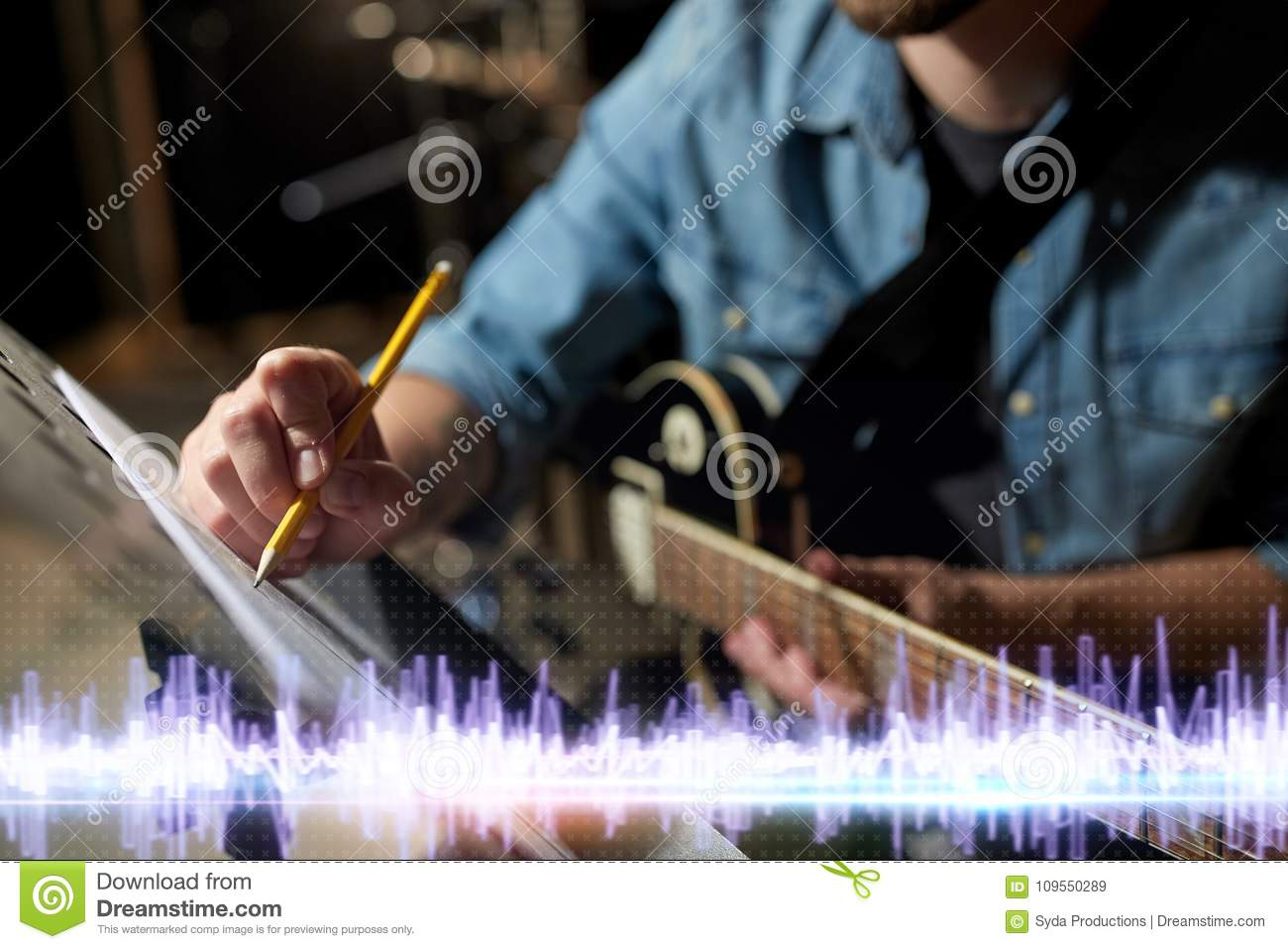 Cross Guitar Book Musician With Guitar And Music Book At Studio Stock Image