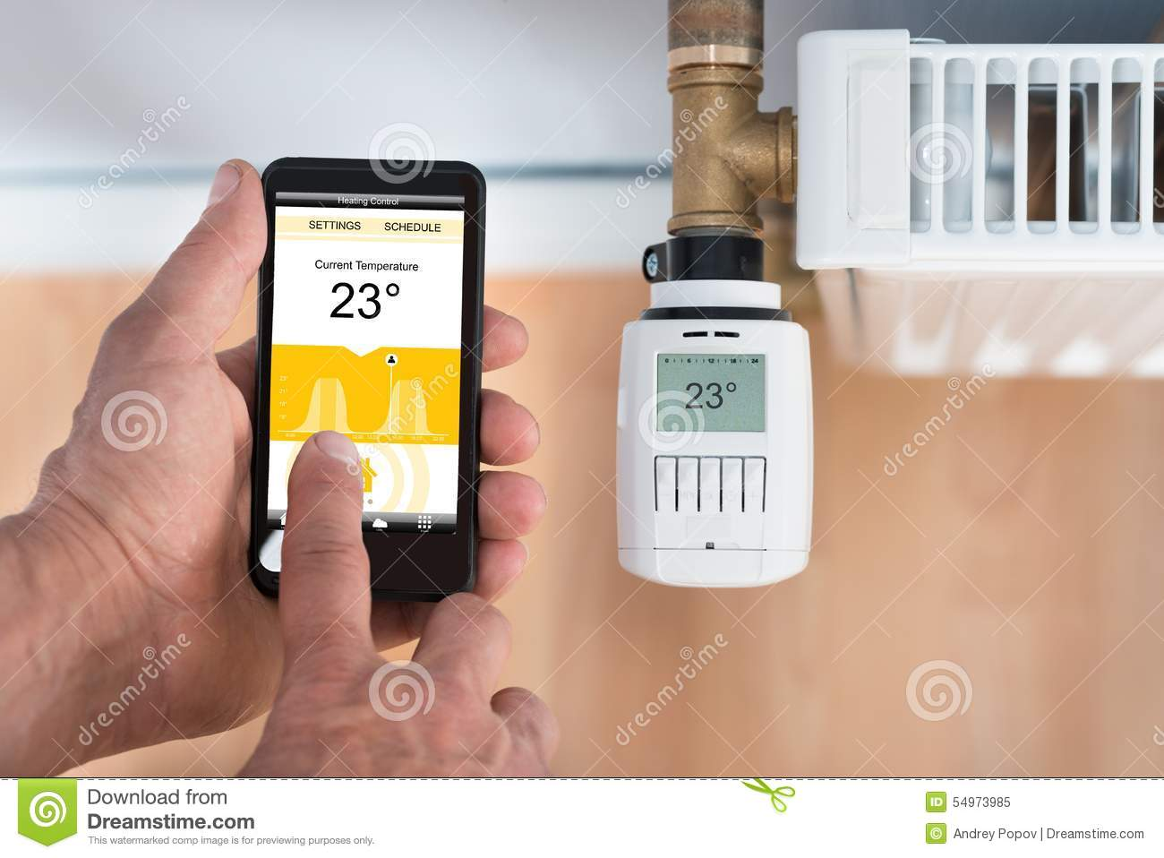 Voreinstellbare Thermostatventile Person Hand Adjusting Temperature Of Thermostat Using