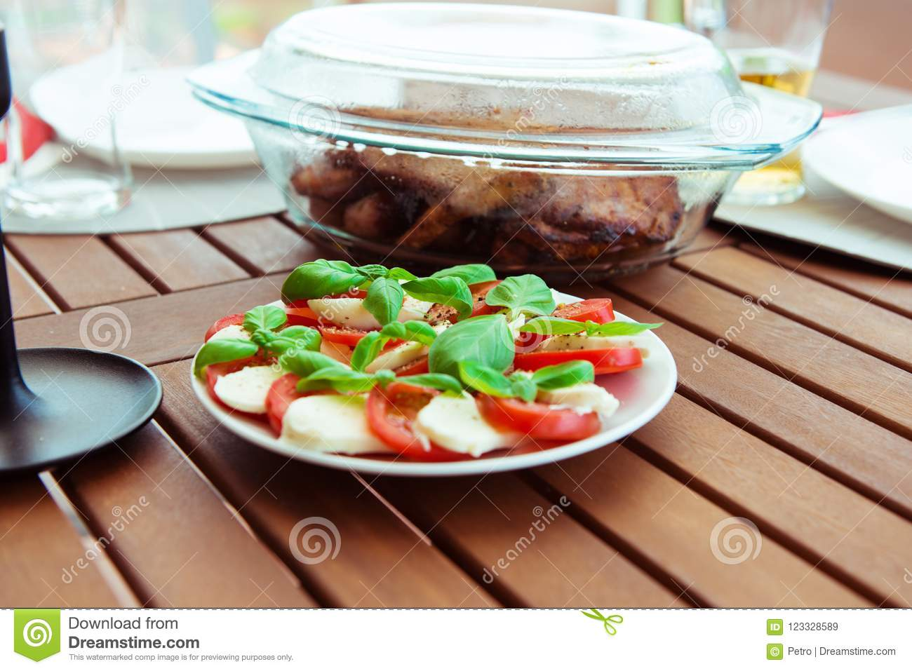 Grill Terrasse Photo Of Caprese Salad With Grilled Meat And Sausages On The Tab