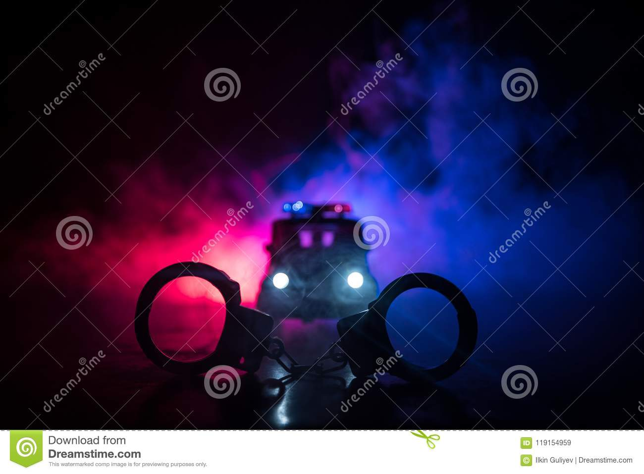 Closed Handcuffs On The Street Pavement At Night With Police Car Lights Stock Image Image Of Background Security 119154959