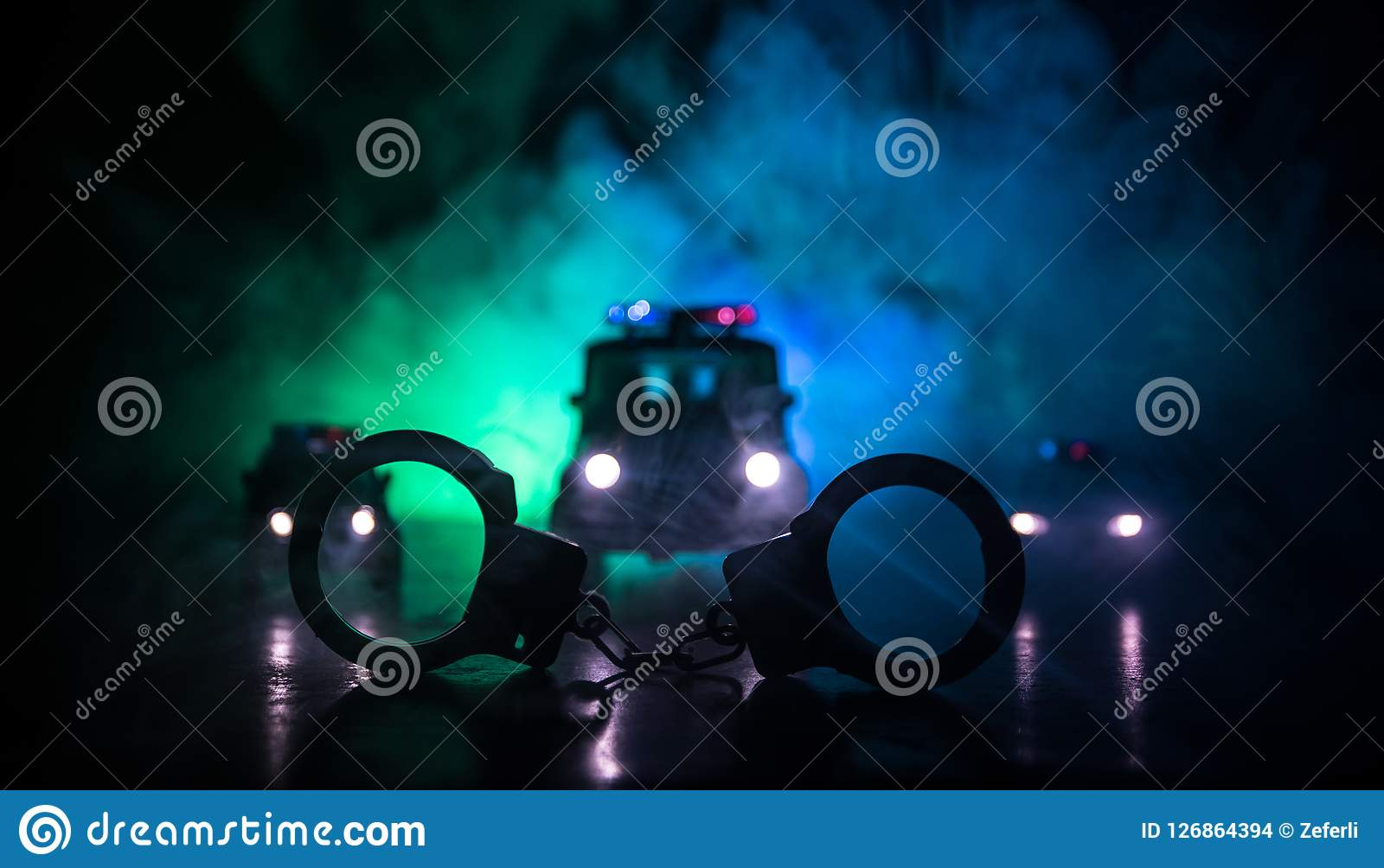 Closed Handcuffs On The Street Pavement At Night With Police Car Lights Stock Photo Image Of Crime Justice 126864394