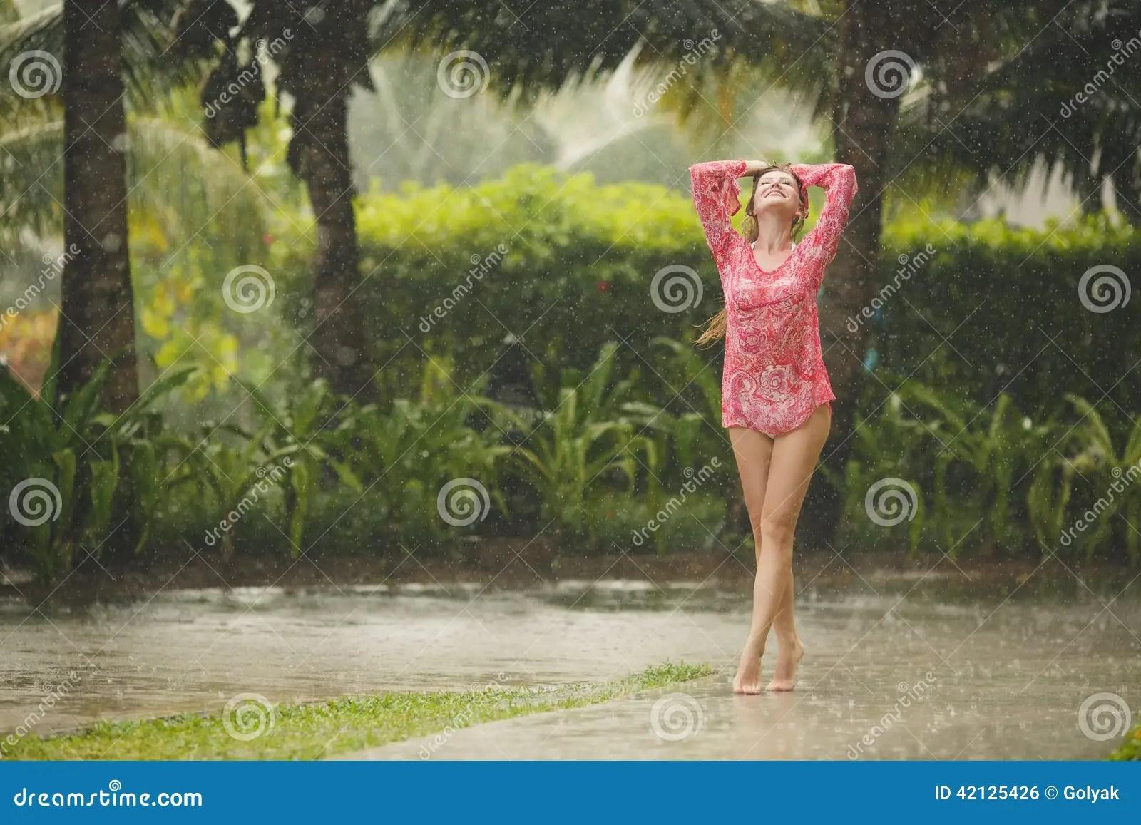 Rainy Fall Day Wallpaper Portrait Of Beautiful Woman Under The Tropical Rain Stock