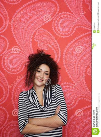 Portrait Of Teenage Girl Against Colorful Wallpaper Stock Images - Image: 31841524
