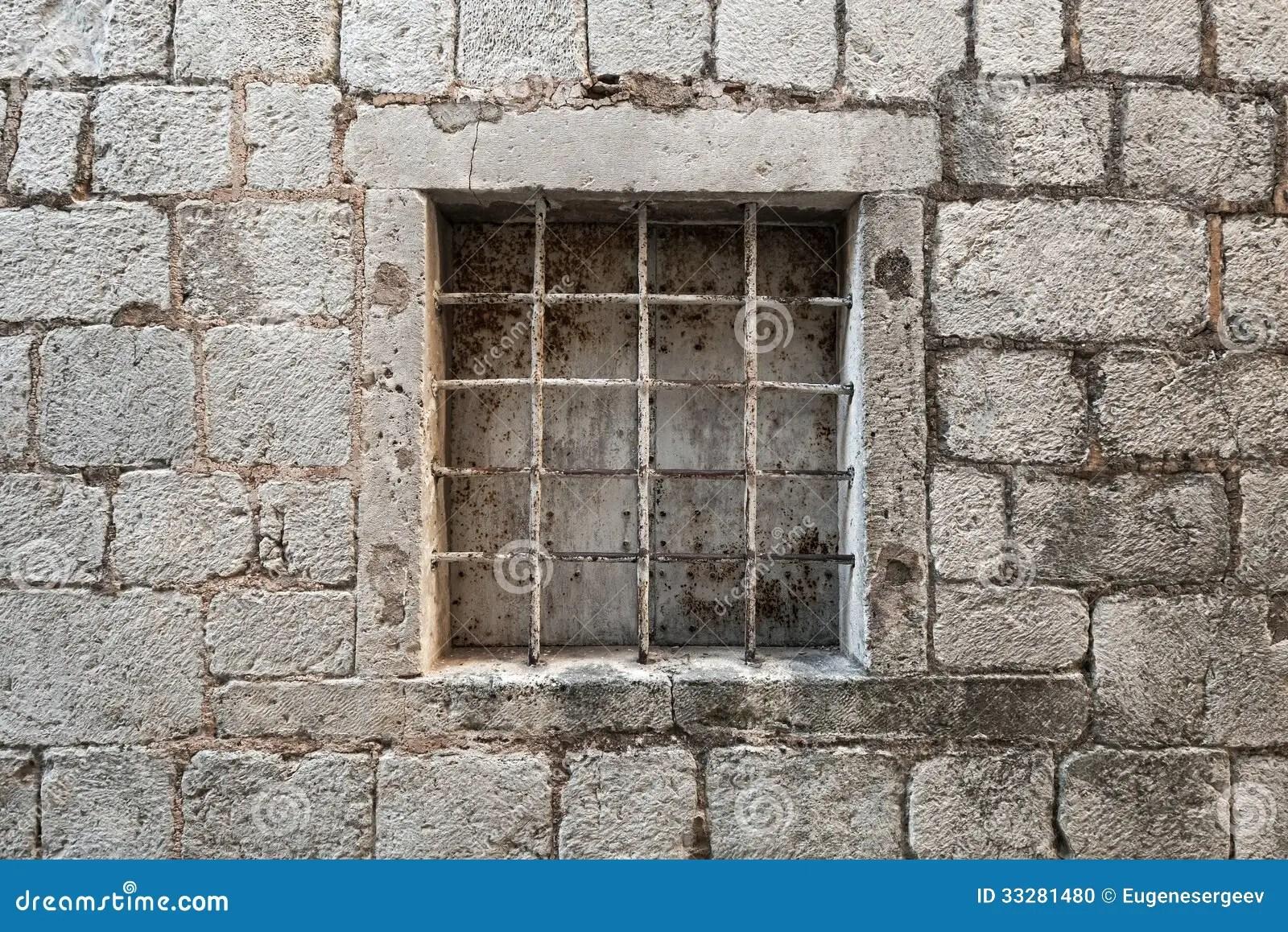 Prison Wall With Metal Window Bars Stock Photo