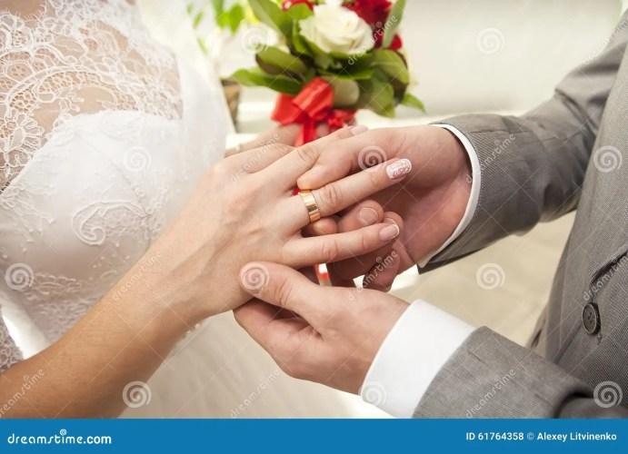 stock photo put wedding ring her finger image wedding ring for her He Put the Wedding Ring on Her