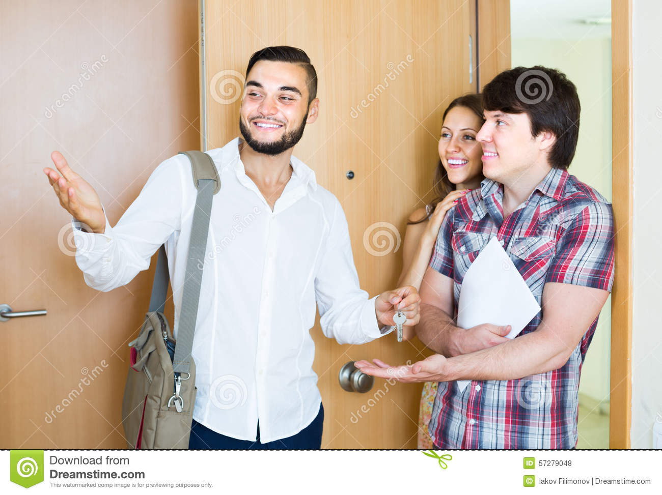 Young Couple Apartment Realtor Showing New Apartment To Couple Stock Photo