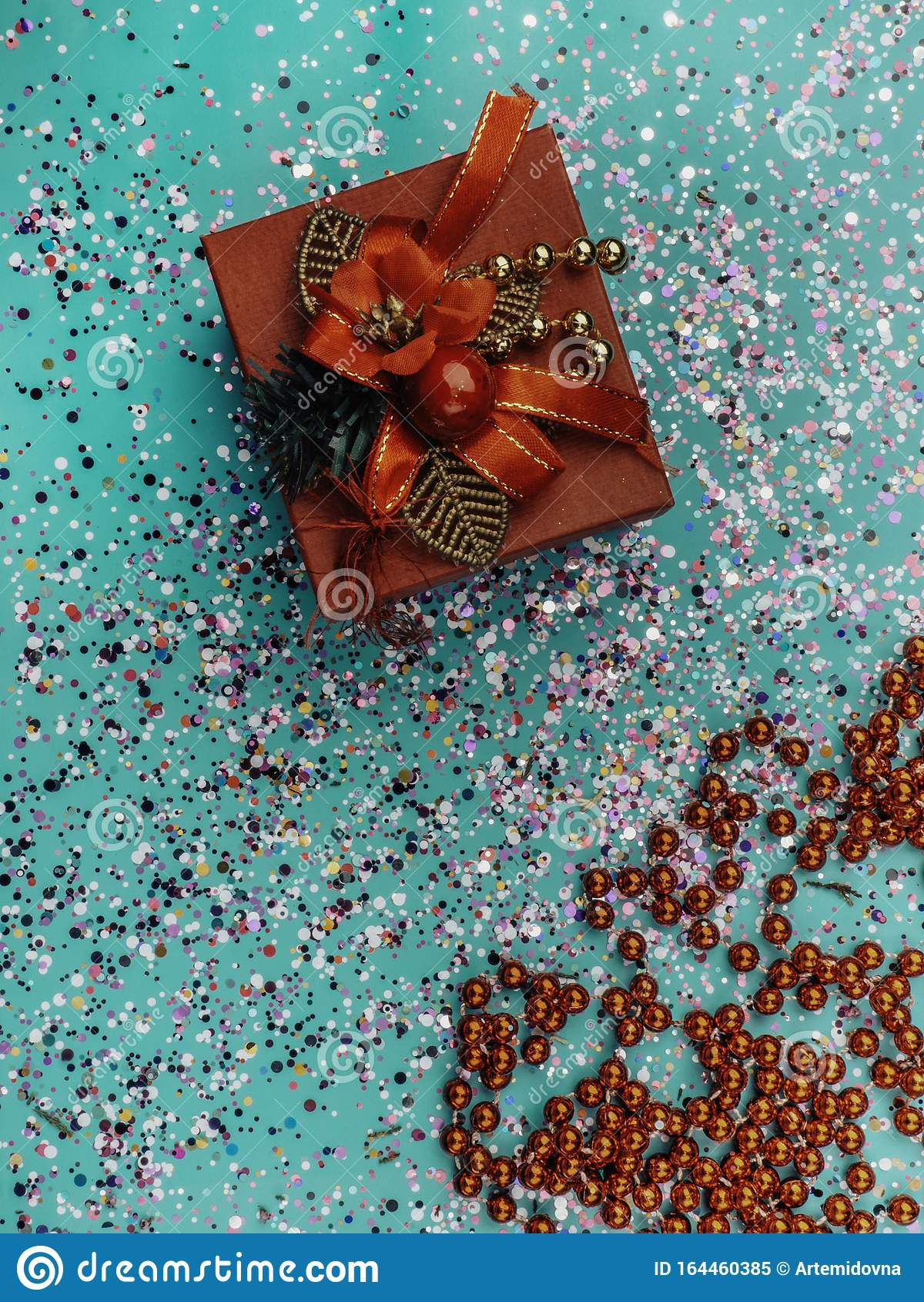 Red Gift Box With Red Decoration On Turquoise Background With Colorful Glitter Cones Holiday Concept Topo View Stock Image Image Of Love Holiday 164460385