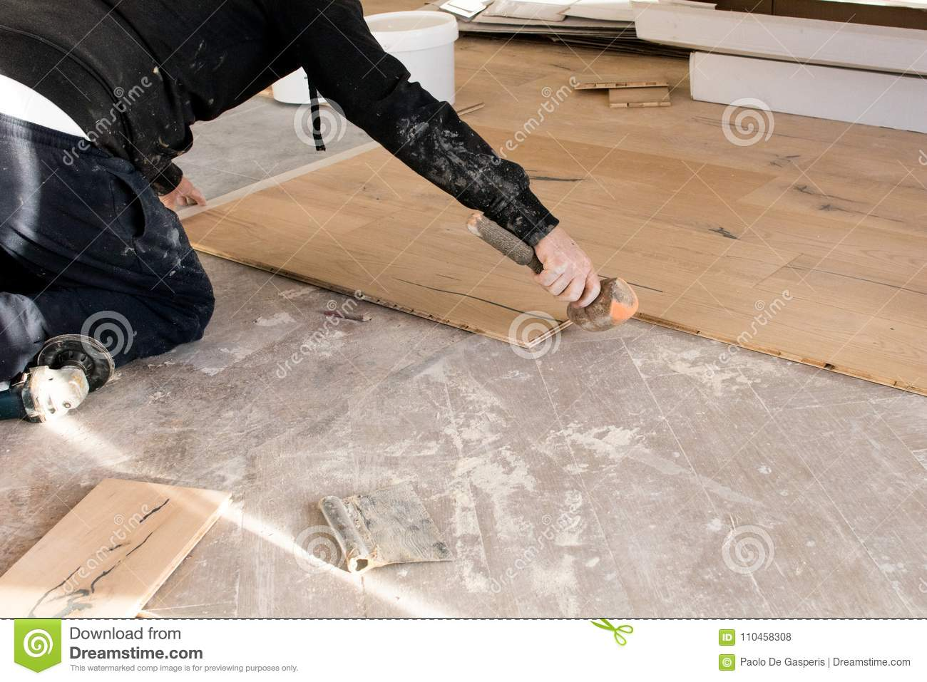 Renovation De Parquet Renovation Of An Apartment Skilled Worker Uses A Plastic Hammer