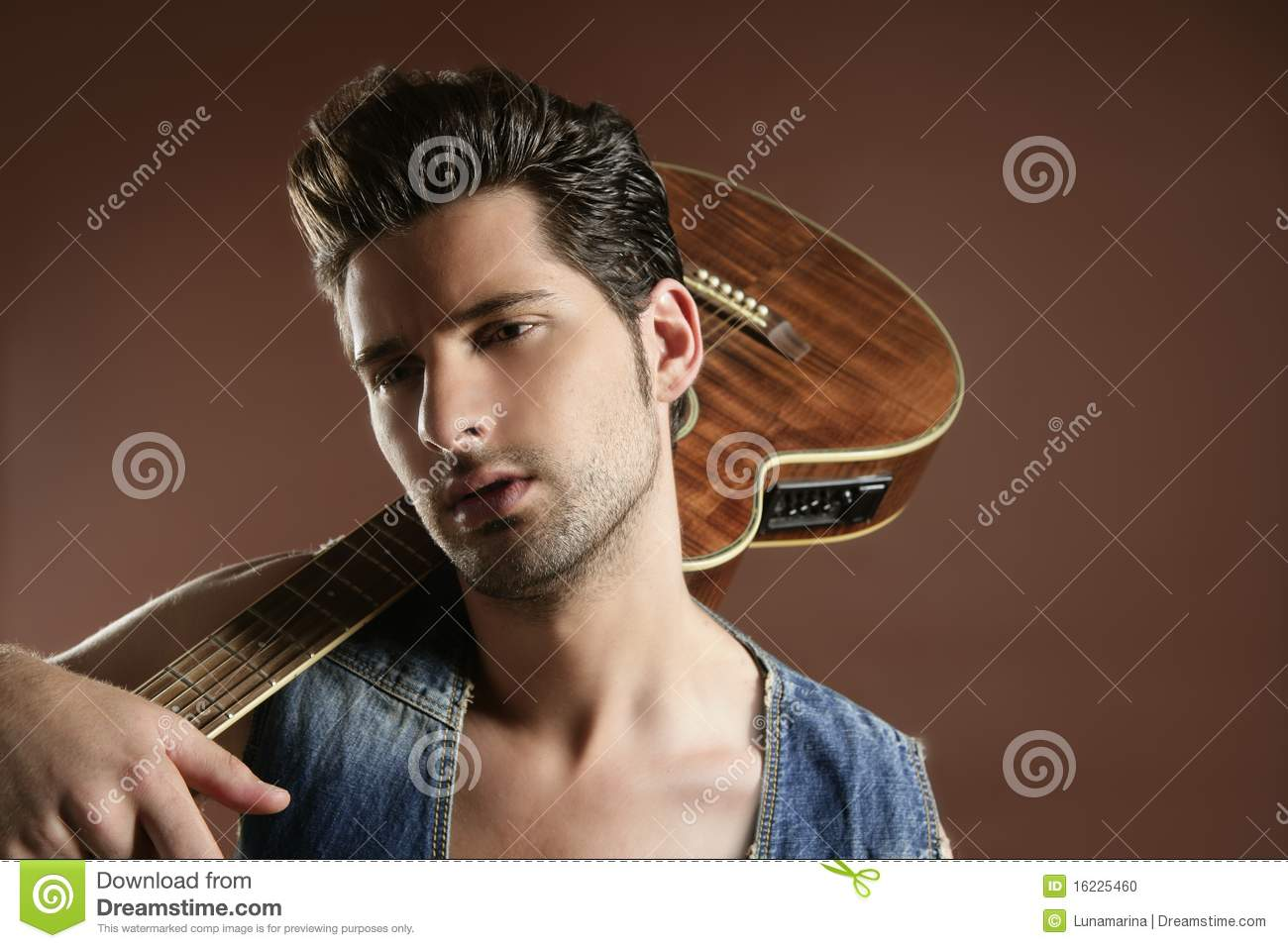 Best Modern Guitar Players Sexy Young Man Musician Guitar Player On Brown Royalty
