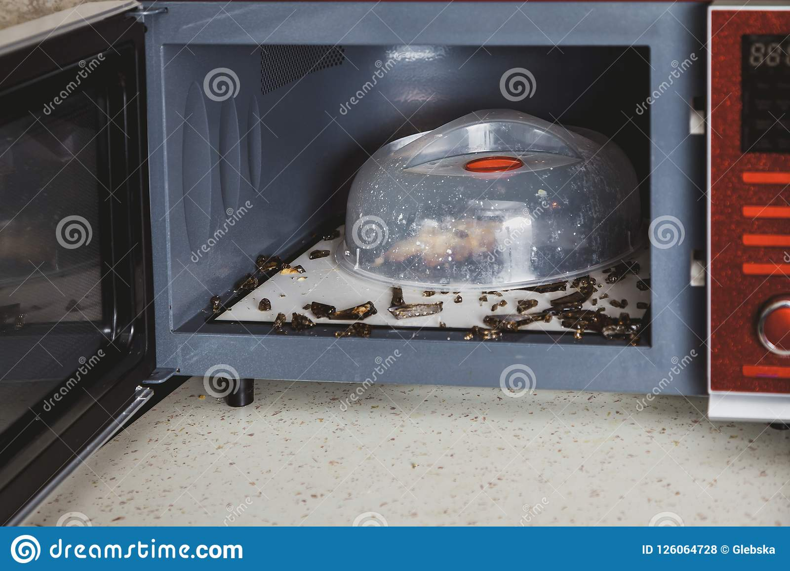 Glass Plate Cover For Microwave Shards Of Glass Plate In Microwave Oven Stock Photo Image Of