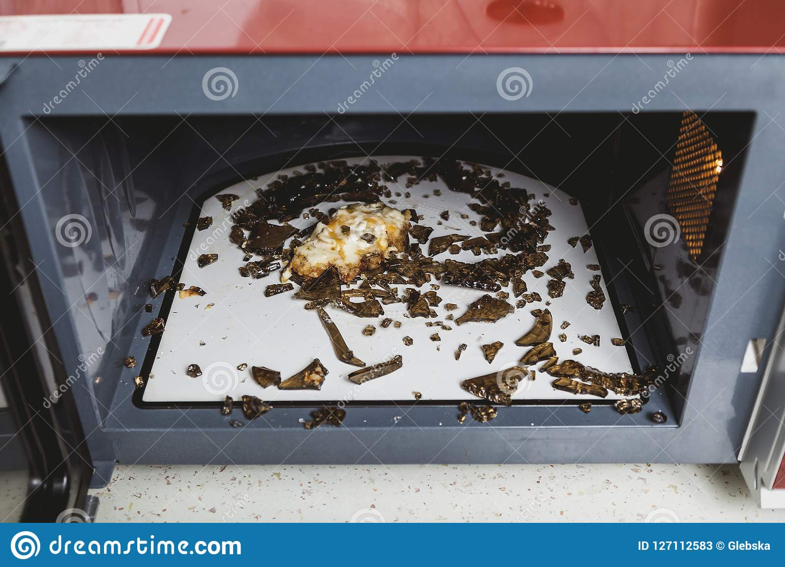 Glass Plate Cover For Microwave Shards Of Glass Plate In Microwave Oven Stock Image Image Of