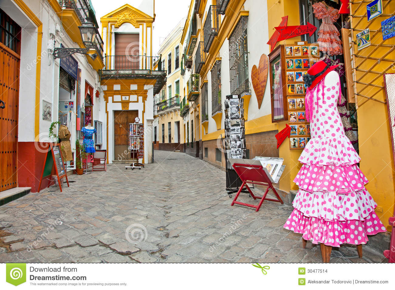 Sevilla Winkelen Shopping Street With Typical Flamenco Dress In Seville