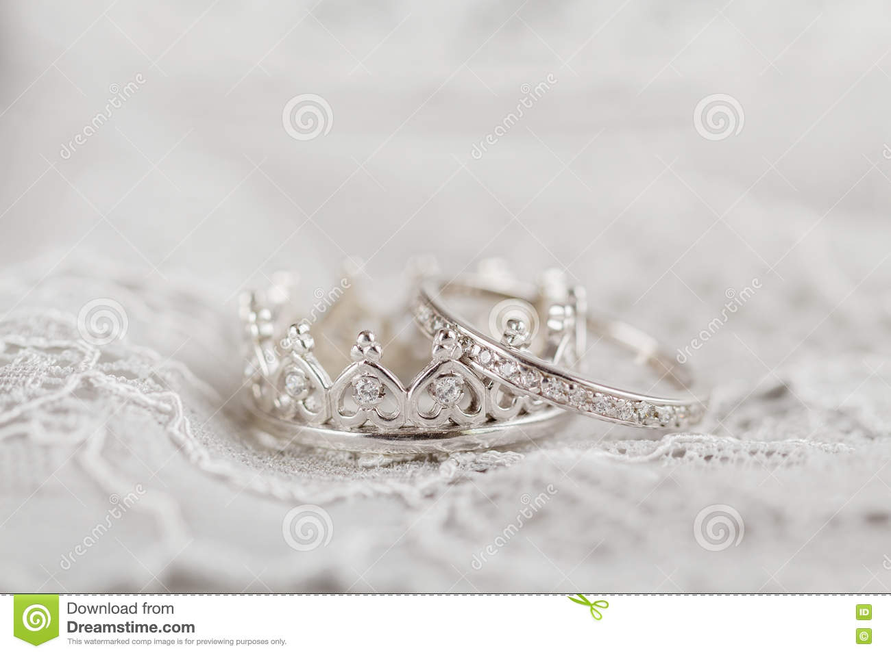 stock photo silver crown wedding rings shape gray background shallow focus image crown wedding rings Silver crown wedding rings