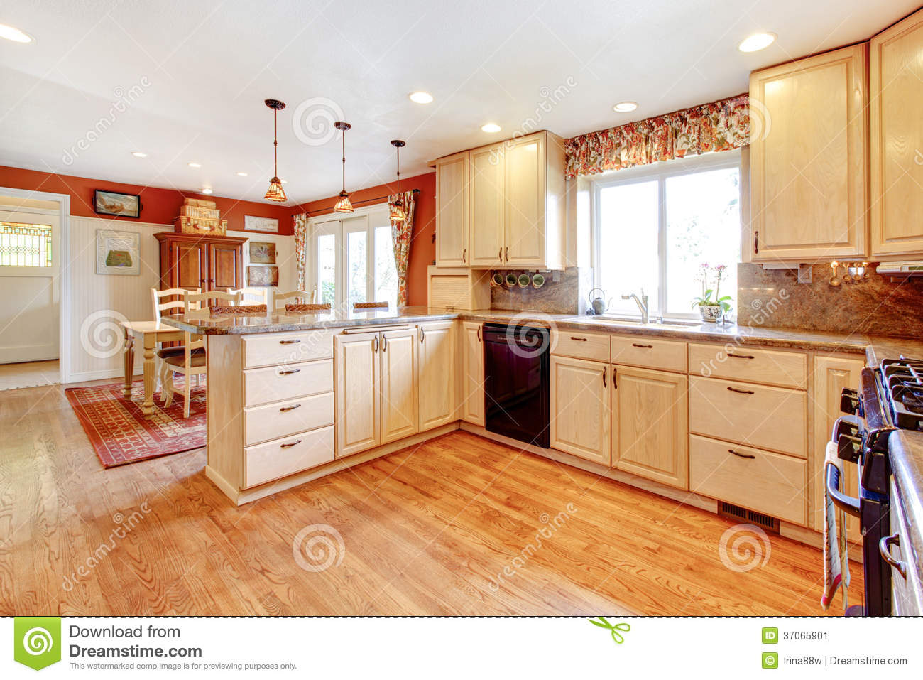 Small Enclosed Kitchen Design Simple Warm Colors Kitchen Room With A Small Dining Area Stock Image