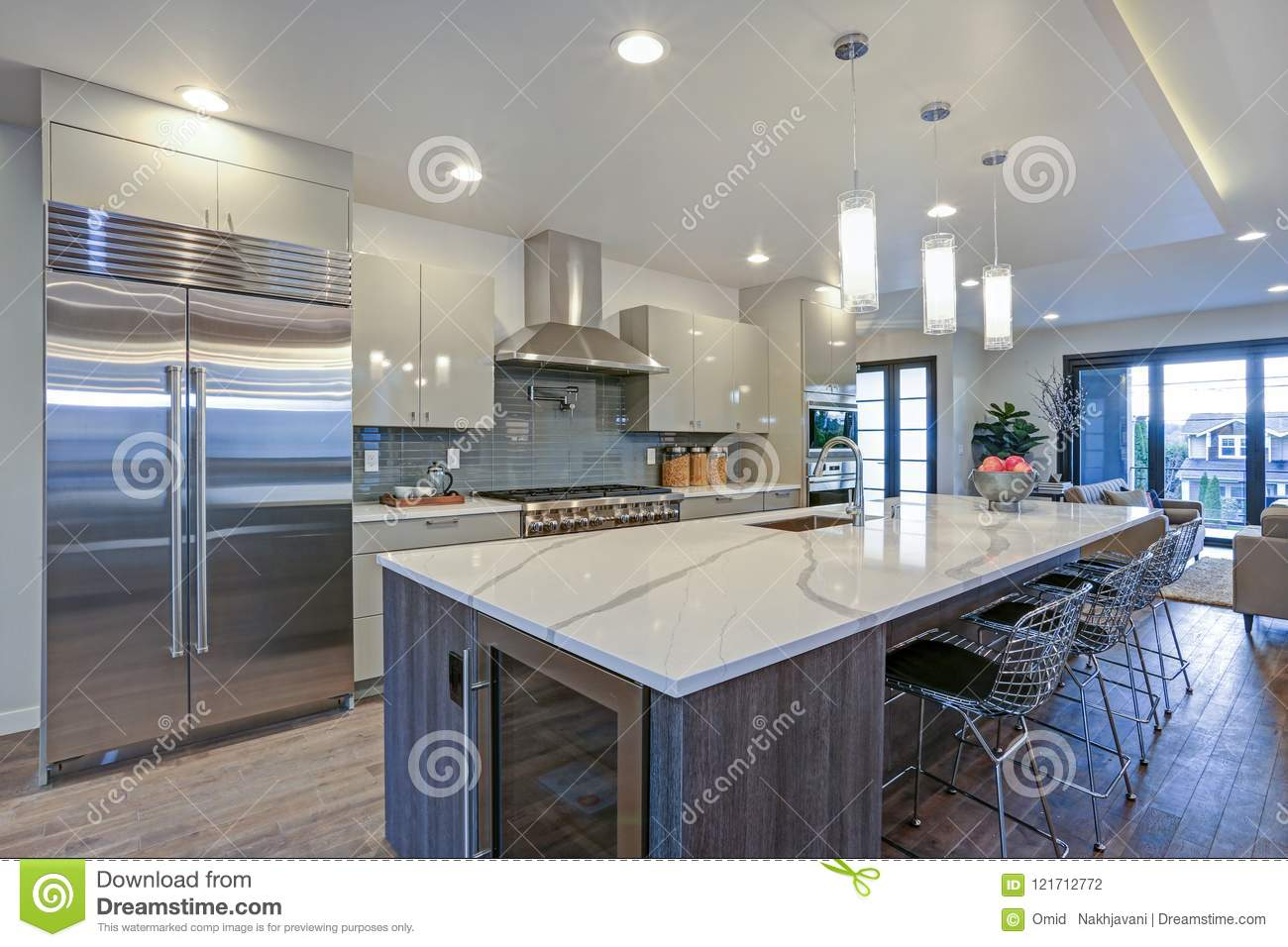 Long Kitchen Design Pictures Sleek Modern Kitchen Design With A Gray Center Island Stock Photo
