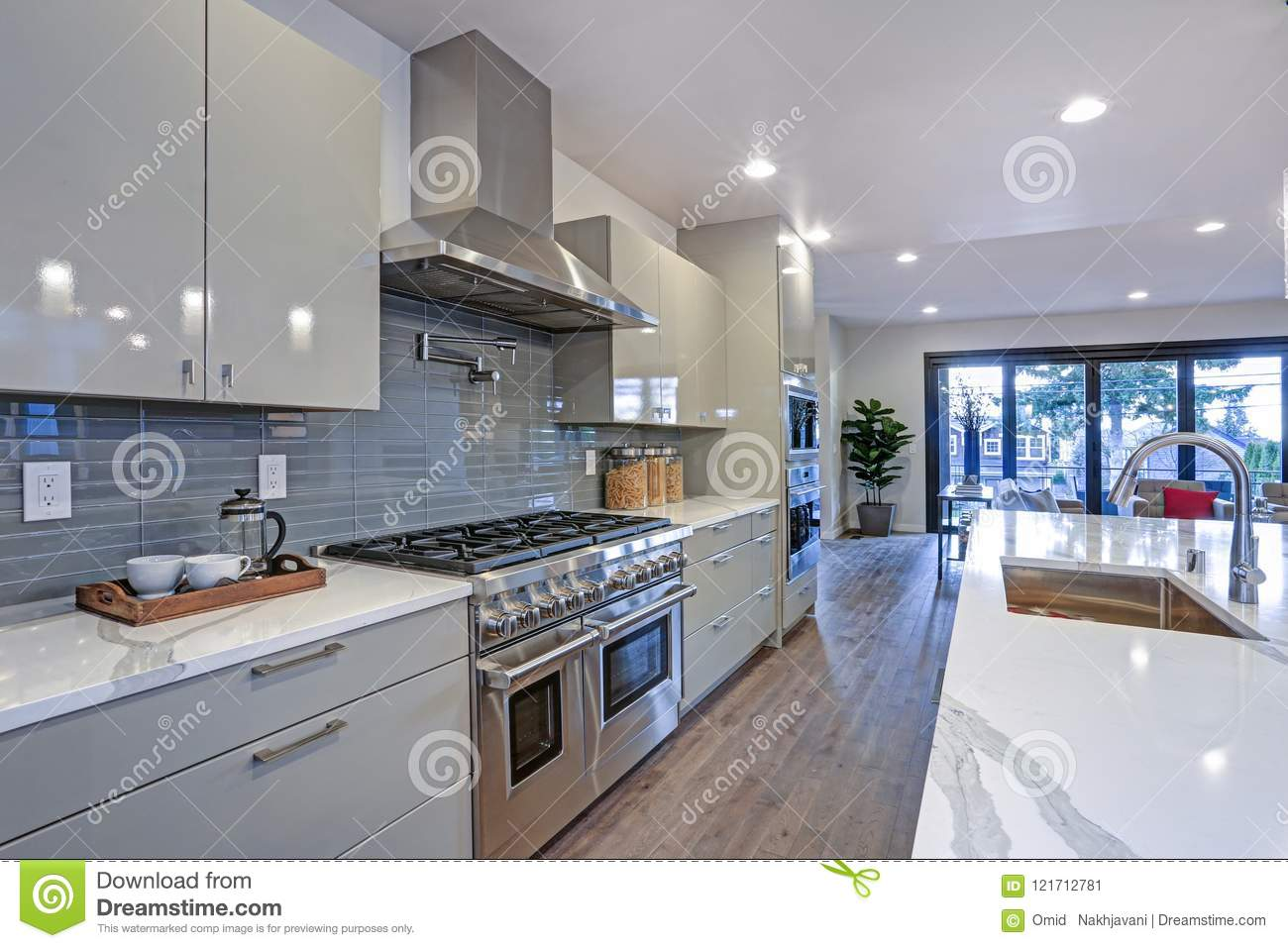 Long Kitchen Design Pictures Sleek Modern Kitchen Design With An Island Stock Image Image Of