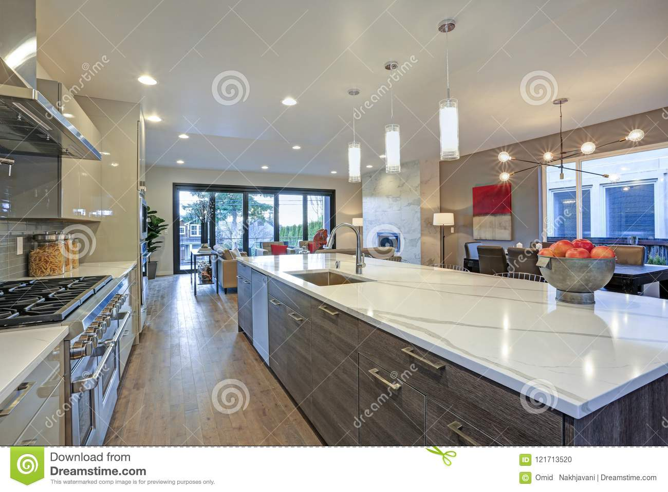Long Kitchen Design Pictures Sleek Modern Kitchen Design With A Long Center Island Stock Photo