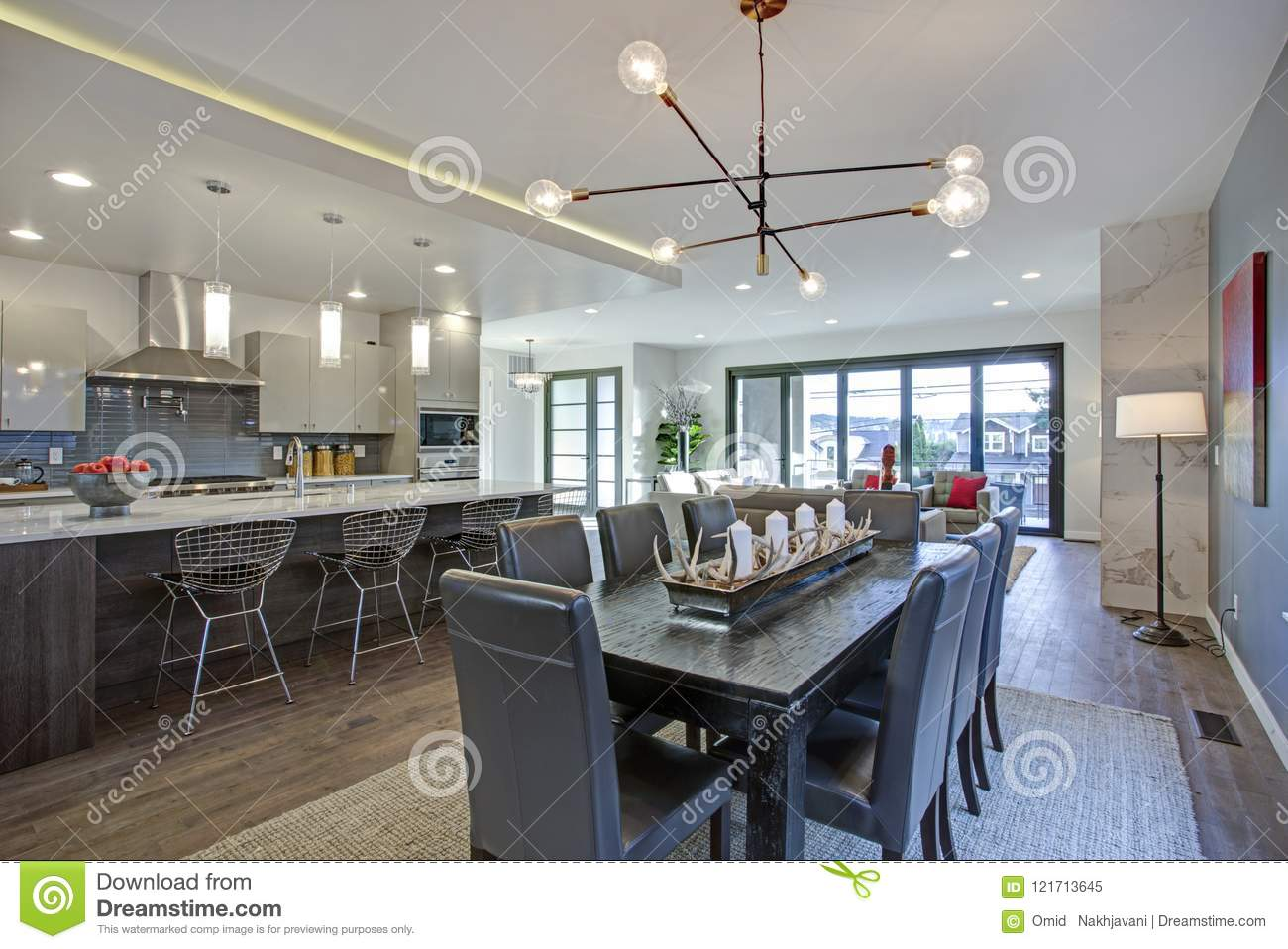 Long Kitchen Design Pictures Sleek Modern Kitchen Design With A Long Center Island Stock Image