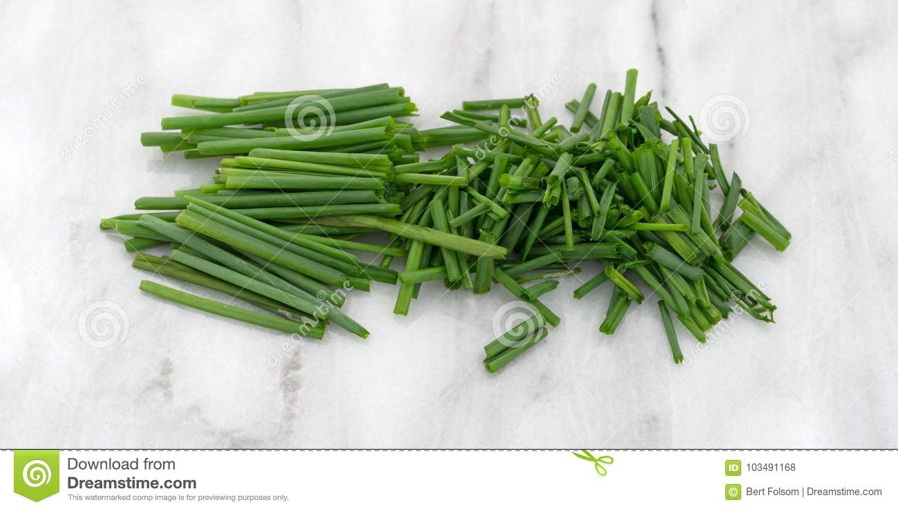 Small Marble Cutting Board Small Pile Of Cut Chives Atop A Gray Marble Cutting Board Stock
