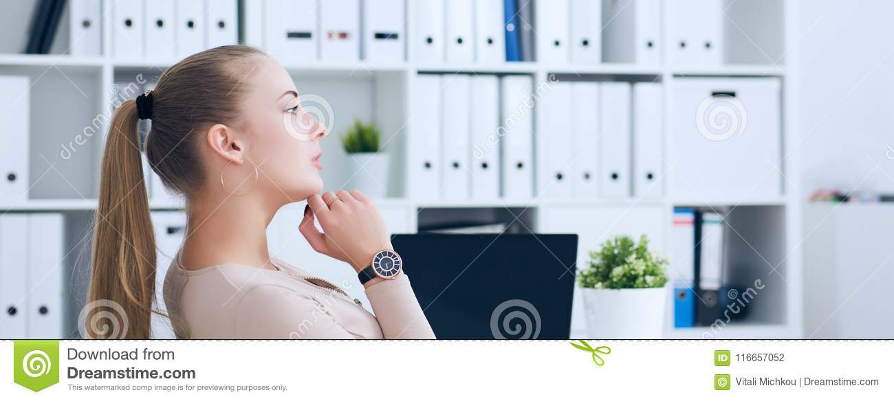Side View Of Smiling Woman Boss Relaxing And Holding Legs On Office