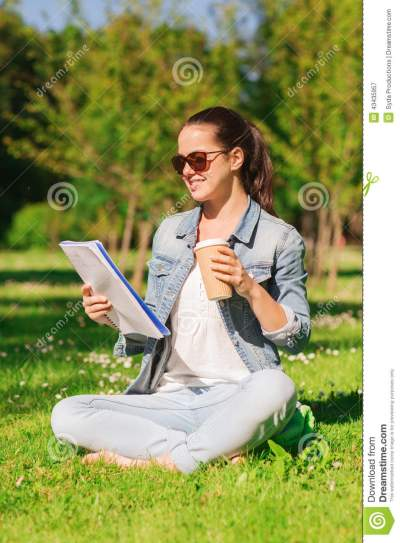 Smiling Young Girl With Notebook And Coffee Cup Stock ...