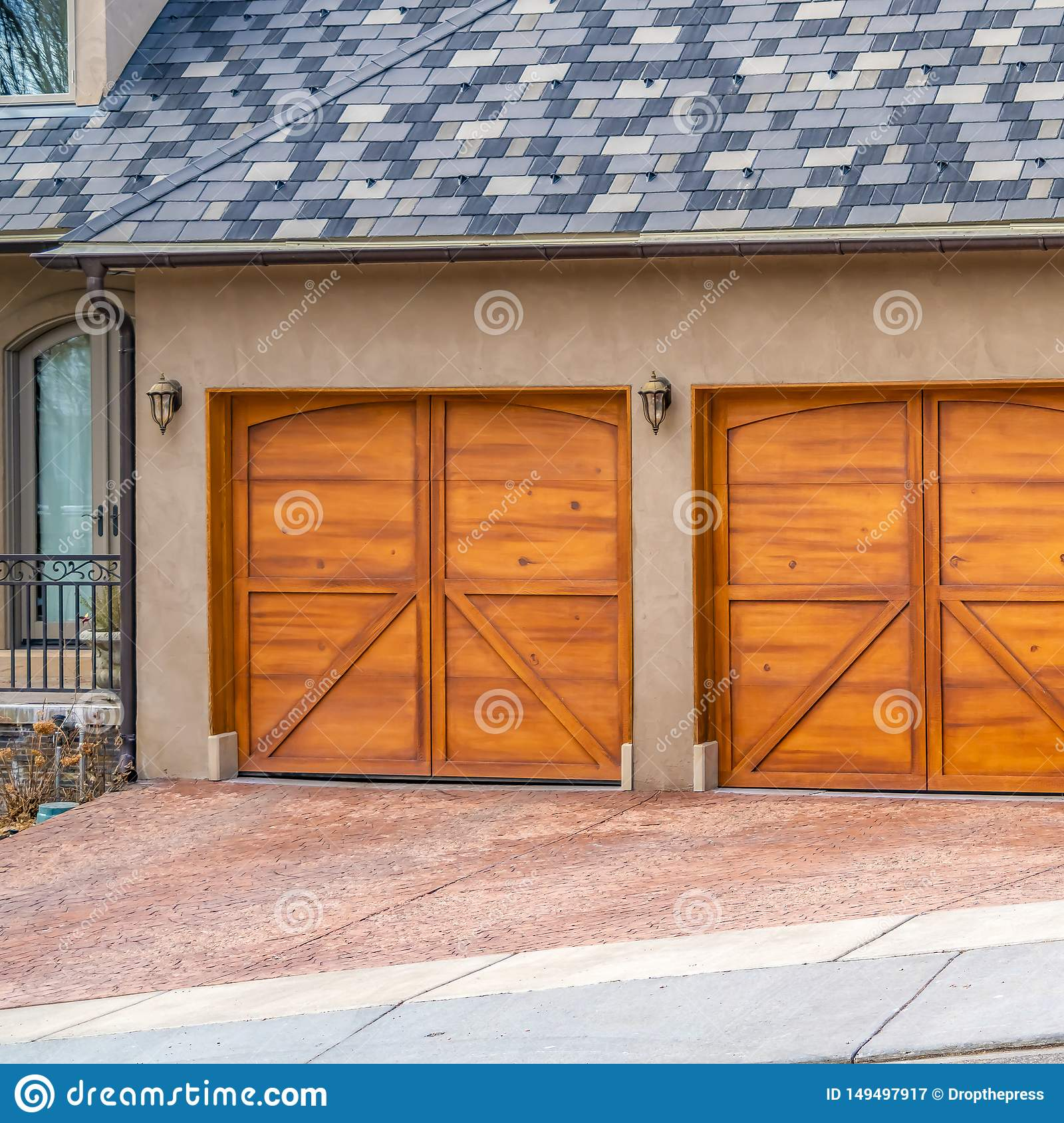 Square House Exterior With Gray And White Roof And Stylish Wooden Garage Doors Stock Image Image Of Home Wall 149497917