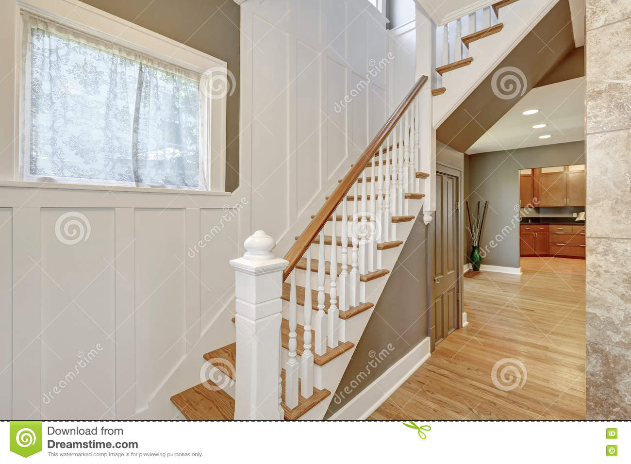Paneled Staircase Staircase With White And Brown Railings And Wood Paneled