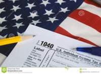 Income Tax 1040 Form On Flag Royalty Free Stock Image