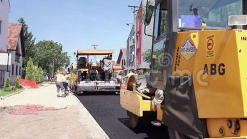 Tarmac Road Laying Machine In Road Construction Activity Workers - asphalting machine