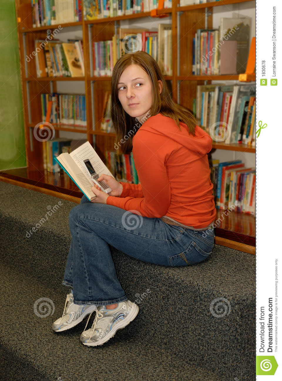 Smart College Girl Wallpaper Teen Girl In Library Hiding Cell Phone Royalty Free Stock