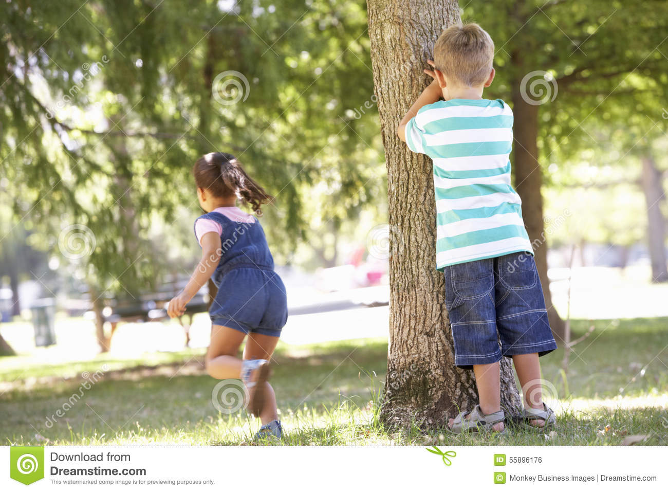 Hide And Seek Kids Two Children Playing Hide And Seek In Park Stock Photo Image Of
