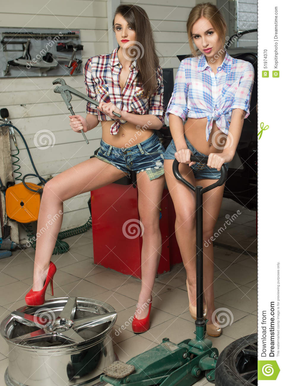 Classic Car Wallpaper Murals Two Girls Mechanic Replace Tires On Wheels Stock Photo