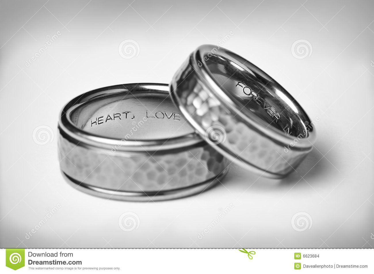 stock images two titanium silver wedding bands white image silver wedding rings Two Titanium Silver Wedding Bands On White